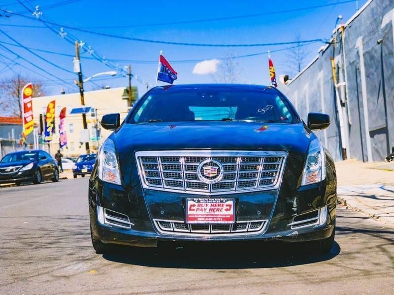 Cadillac XTS 2013 price $18,400