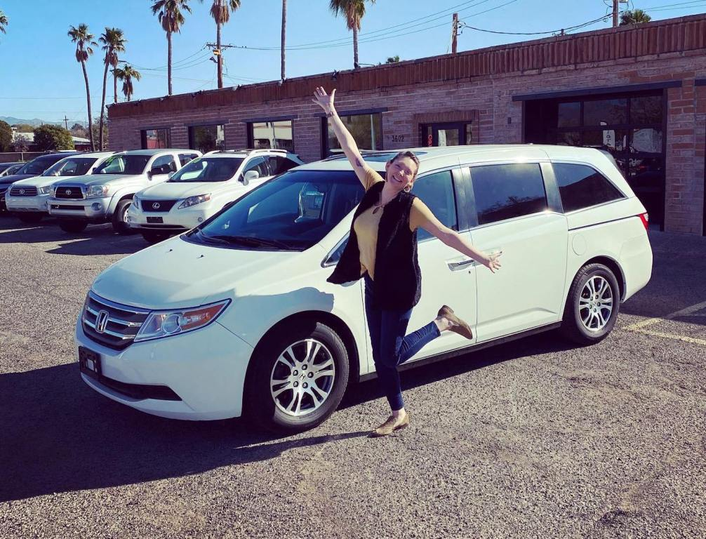 Happy woman with her new Honda Odyssey van