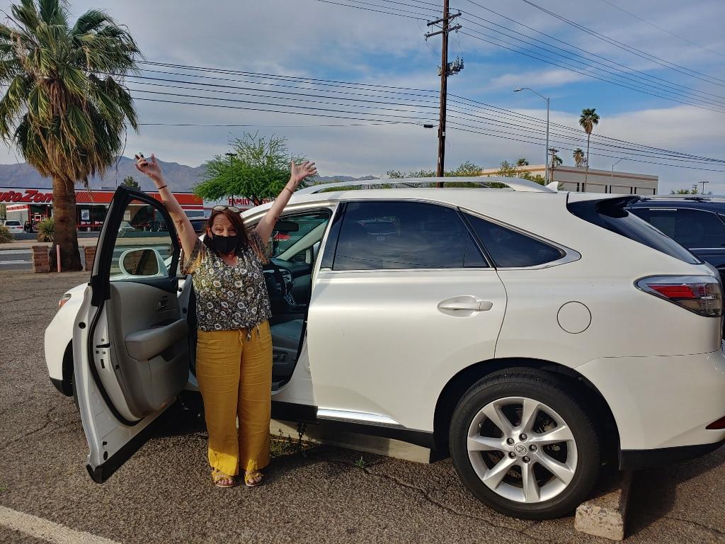 Happy lady with new Lexus RX 350
