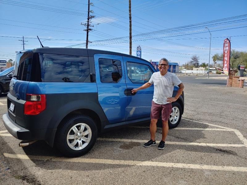 Happy man with his new Honda Element