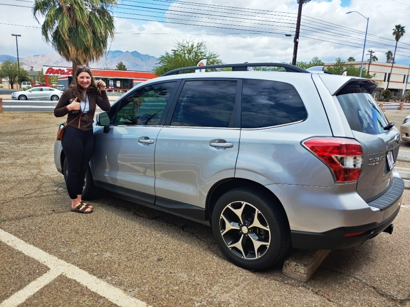 Young woman is so happy with her new Subaru!