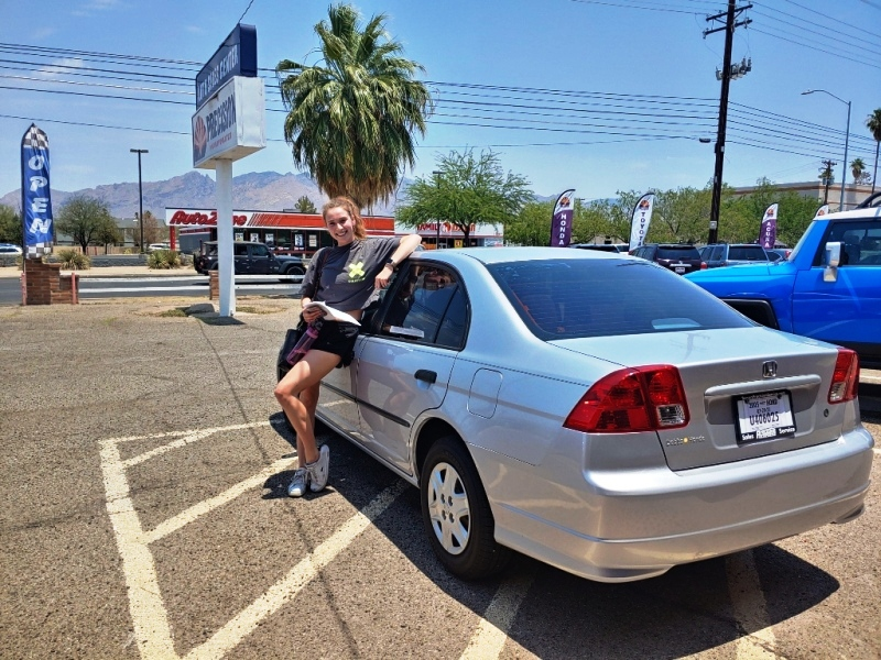 A very happy new Honda Civic owner.