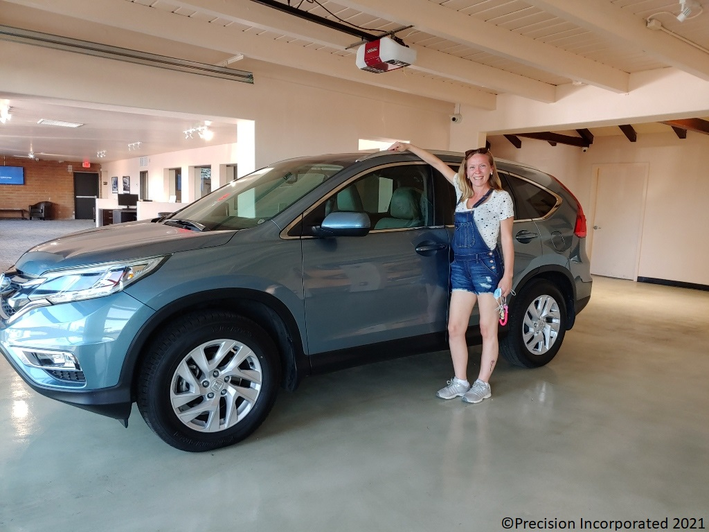 Happy woman with new Honda CR-V