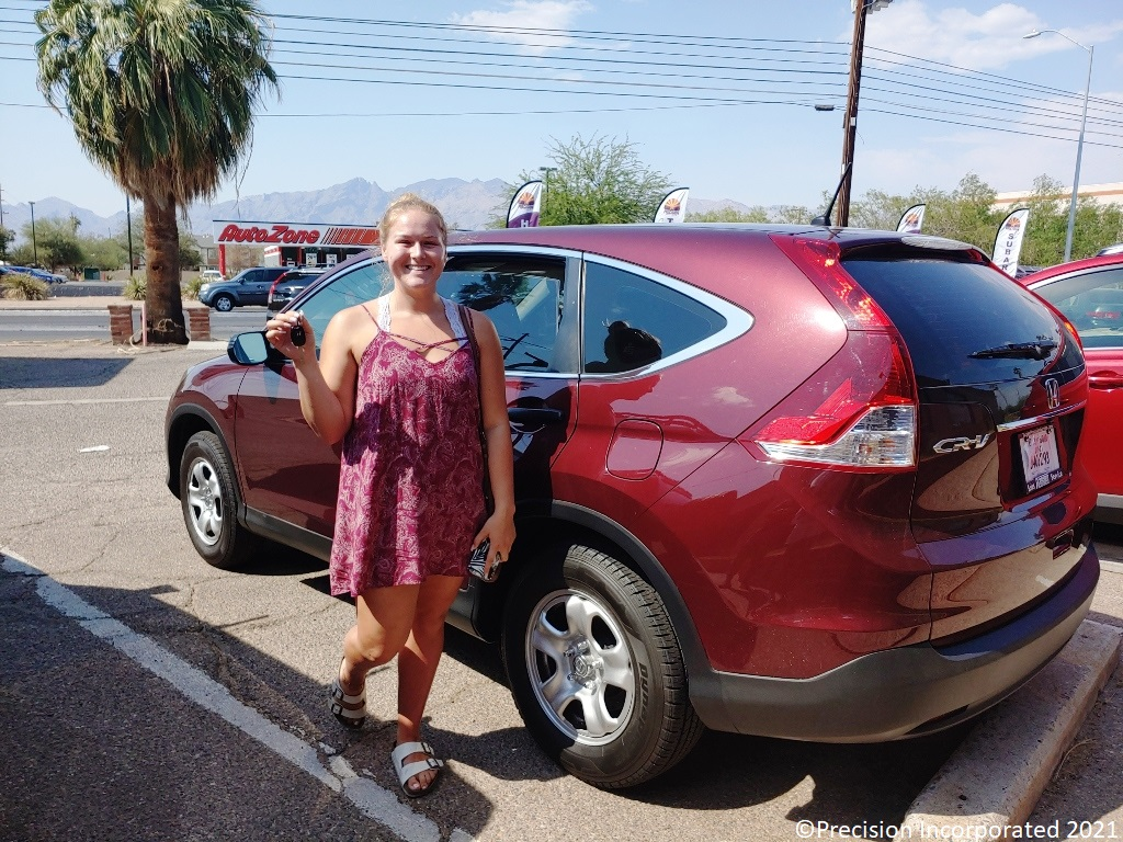 Young woman with her first Honda CR-V