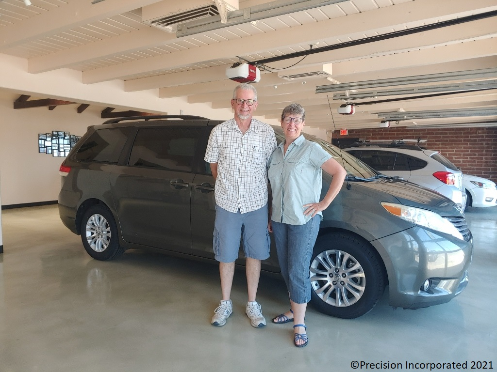 Happy couple with their new Toyota Sienna van.