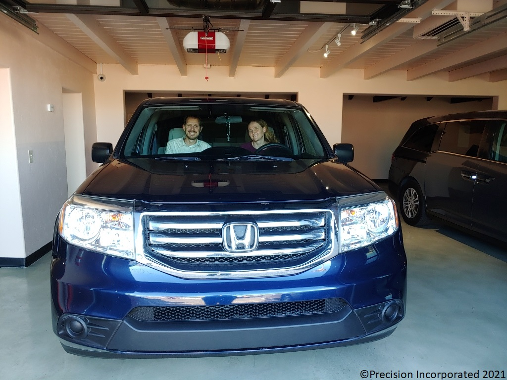 Husband & Wife smiling inside their new Honda Pilot