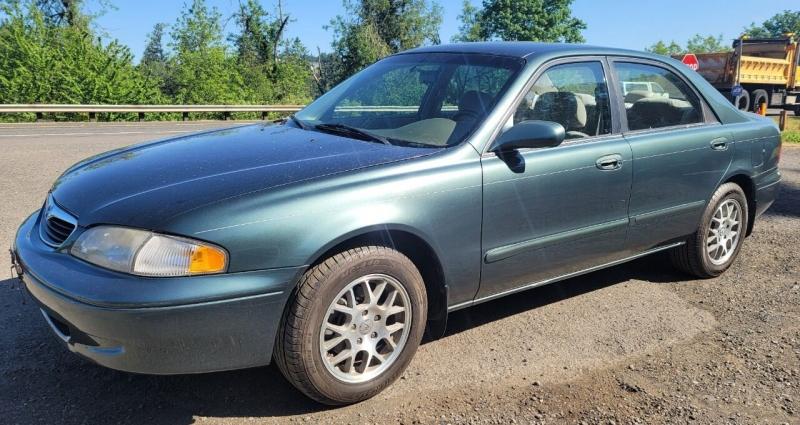 Mazda 626 1999 price $2,650