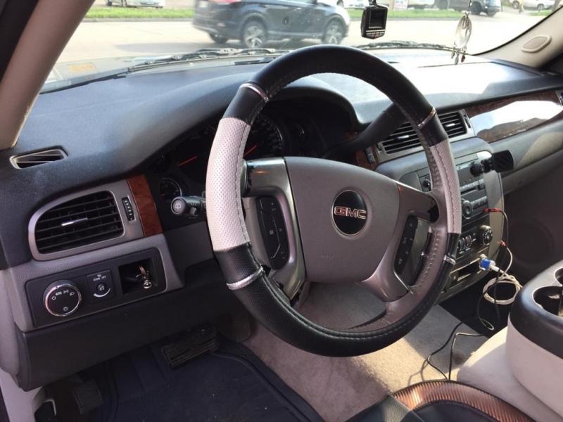 GMC Yukon 2009 price $9,299