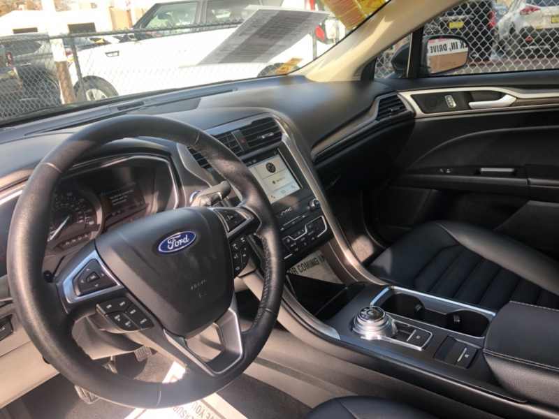 Ford Fusion 2019 price $18,999