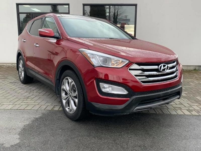 Hyundai Santa Fe 2013 price $16,869