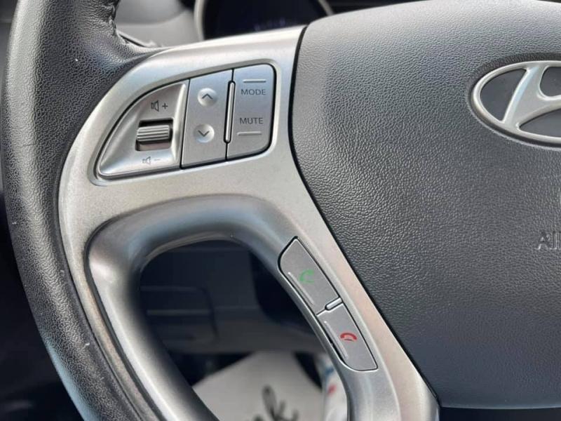 Hyundai Tucson 2012 price $12,869