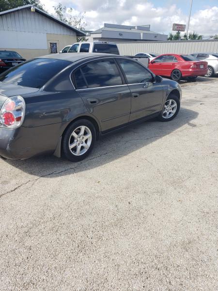 Nissan Altima 2006 price $3,299