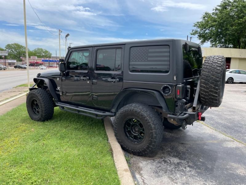Jeep Wrangler Unlimited 2014 price $25,700