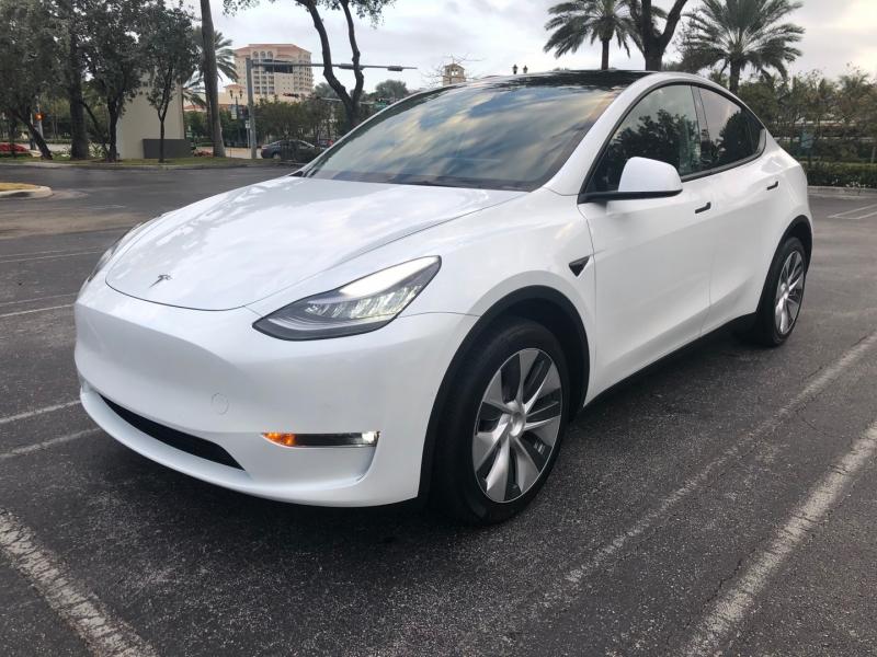 Tesla Model Y 2021 price $57,995