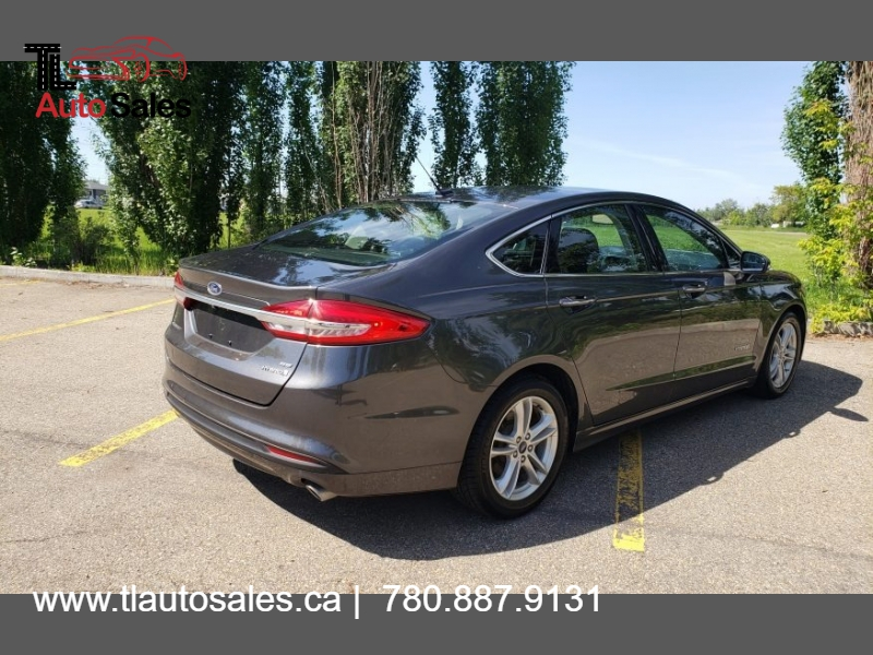 Ford Fusion Hybrid 2018 price $14,999