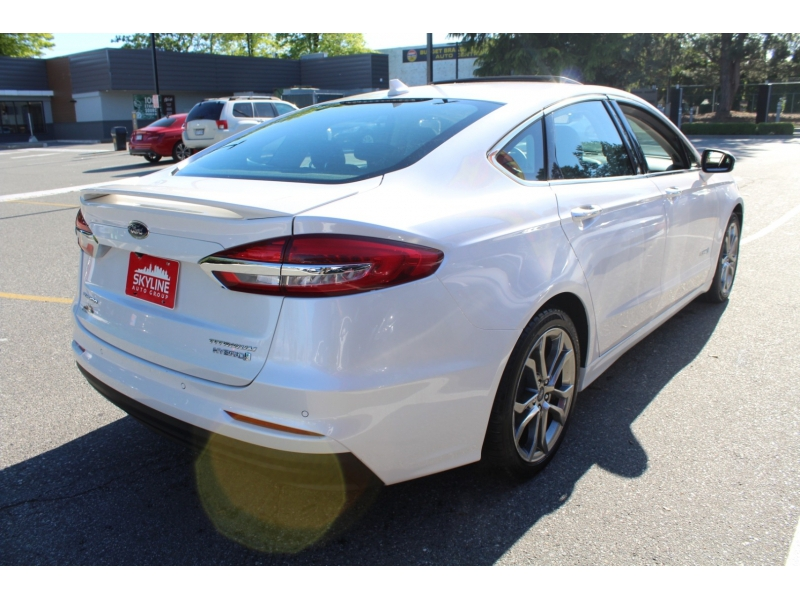 Ford Fusion Hybrid 2019 price $25,889